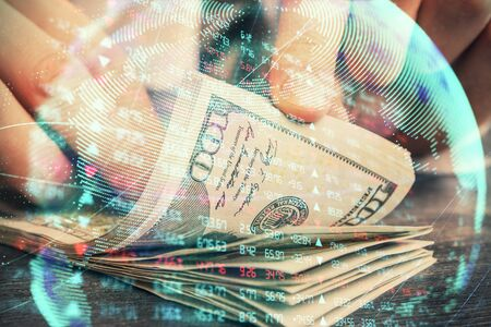 Multi exposure of financial theme drawing hologram and USA dollars bills and man hands. Business concept.