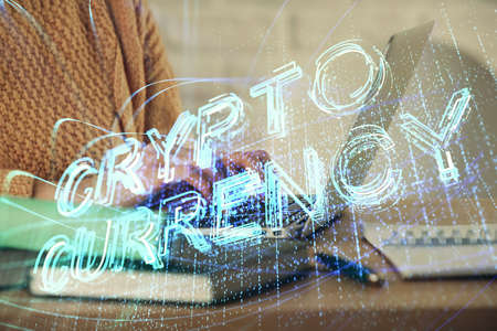Double exposure of woman hands typing on computer and crypt market theme hologram drawing. Blockchain concept.