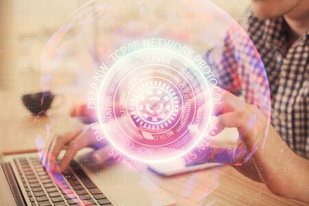 Double exposure of man hands holding a credit card and tech theme drawing. Technology in E-commerce concept. Stok Fotoğraf