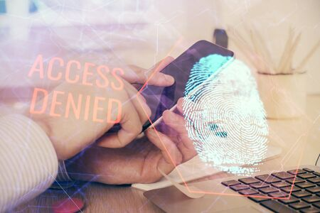 Double exposure of mans hands holding and using a digital device and fingerprint hologram drawing. Security concept.