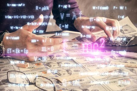 Double exposure of mans hands holding and using a phone and formulas drawing. Education concept. Banco de Imagens