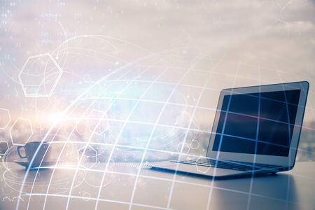 Multi exposure of table with computer and world map hologram. International data network concept. Stock Photo