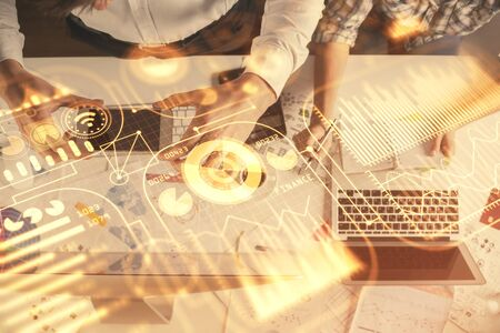 Double exposure of man and woman working together and technology theme drawing. Computer background. Top View. High tech concept.