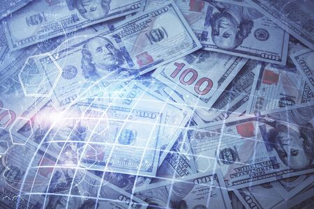 Double exposure of world map drawing over us dollars bill background. International concept.