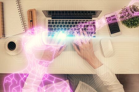 Double exposure of woman hands working on computer and man in ar glasses hologram drawing. Top View. Virtual reality concept.