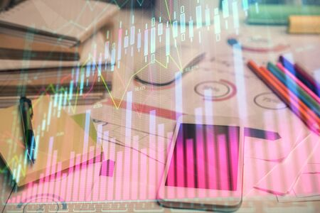 Double exposure of forex chart drawing and cell phone background. Concept of financial data analysis