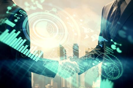Double exposure of business theme hologram and handshake of two men. Success concept. Stockfoto