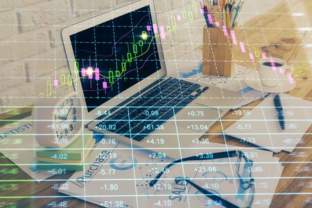 Double exposure of forex chart and work space with computer. Concept of international online trading. Stok Fotoğraf