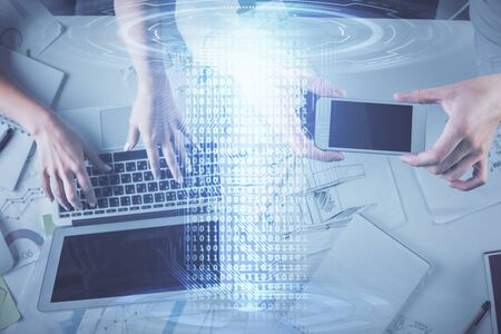 Double exposure of man and woman working together and data theme hologram drawing. Computer background. Top View.