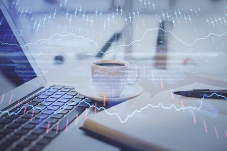 Double exposure of financial chart drawing and desktop with coffee and items on table background. Concept of forex market trading Stok Fotoğraf