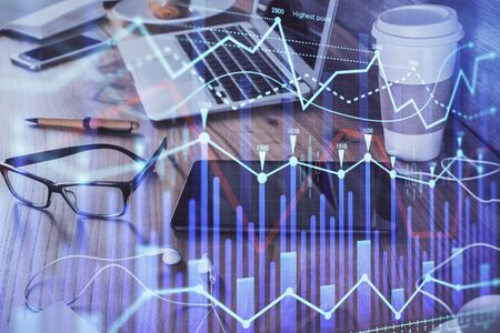 Double exposure of forex chart drawing and cell phone background. Concept of financial trading Archivio Fotografico - 150118383