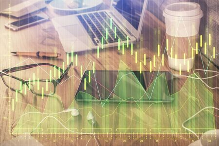 Double exposure of financial graph drawing and cell phone background. Concept of forex trading Archivio Fotografico