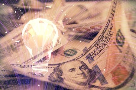 Double exposure of light bulb drawing over usa dollars bill background. Concept of idea.