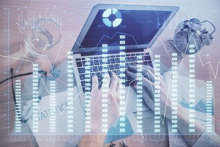 Multi exposure of forex graph with man working on computer on background. Concept of market analysis.