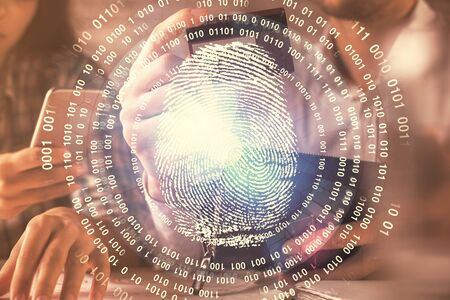 Double exposure of man and woman on-line shopping holding a credit card and fingerprint hologram drawing. Security in E-commerce concept.