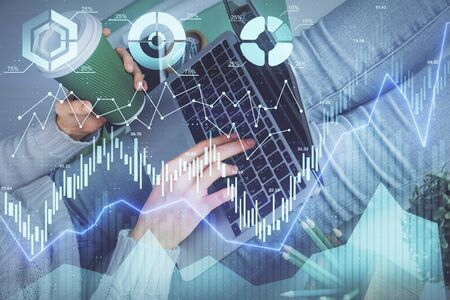 Double exposure of woman hands typing on computer and forex chart hologram drawing. Stock market invest concept. Stok Fotoğraf