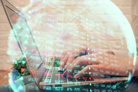 Double exposure of woman hands typing on computer and business theme hologram drawing. Success concept.