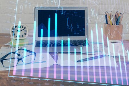 Financial chart drawing and table with computer on background. Multi exposure. Concept of international markets. Фото со стока