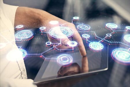 Double exposure of mans hands holding and using a phone and social network theme drawing. Stock Photo