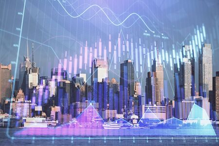 Forex graph on city view with skyscrapers background double exposure. Financial analysis concept. 版權商用圖片