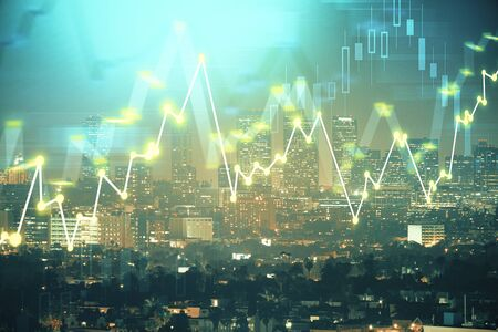 Financial graph on night city scape with tall buildings background multi exposure. Analysis concept.