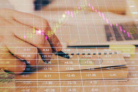 Multi exposure closeup hands with stock market forex graph. Concept of research and analysis.
