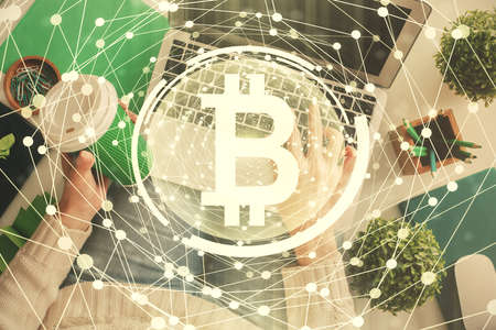 Double exposure of woman hands working on computer and blockchain theme hologram drawing. Top View. bitcoin cryptocurrency concept. Foto de archivo