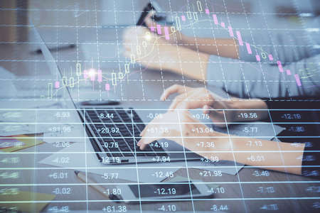 Multi exposure of woman hands typing on computer and financial graph hologram drawing. Stock market analysis concept. 免版税图像