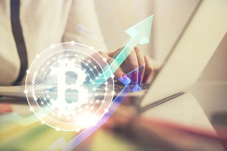 Double exposure of woman hands typing on computer and crypto market theme hologram drawing. Blockchain concept.