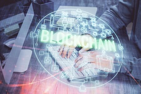 Blockchain theme hud with businessman working on computer on background. Concept of crypto chain. Multi exposure. Foto de archivo