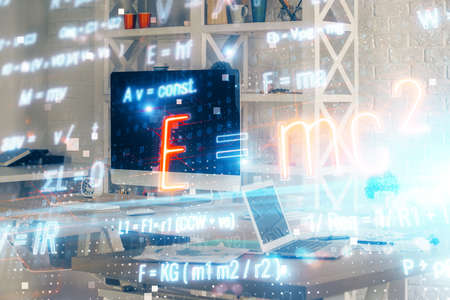 Desktop computer background and formula hologram writing. Double exposure. Education concept. 版權商用圖片