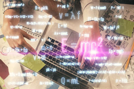 Double exposure of man and woman working together and formula hologram drawing. Computer background. Top View. Education concept.