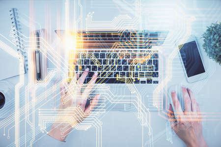 Double exposure of woman hands working on computer and world map hologram drawing. Top View. International business concept. Stock Photo