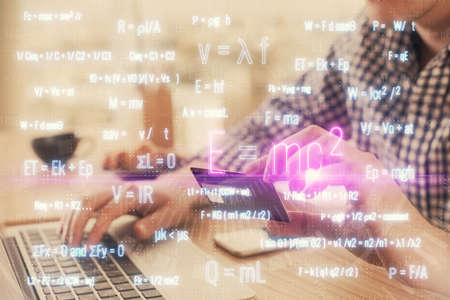 Double exposure of man hands holding a credit card and formula drawing. Education and E-commerce concept. 版權商用圖片