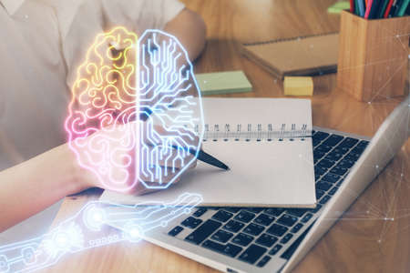Multi exposure of writing hand on background with brain hologram. Concept of self learning. Фото со стока