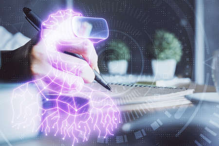 AR hologram over woman's hands taking notes background. Concept of augmented reality. Multi exposure Фото со стока