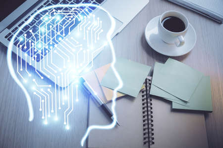 Double exposure of brain drawing hologram over topview work table background with computer. Concept of big data.
