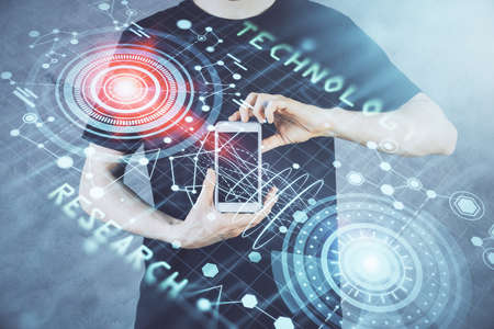 Double exposure of mans hand holding and using a digital device and data theme hologram drawing. Technology concept. Archivio Fotografico