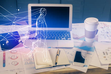 Desktop computer background in office and start up theme hologram drawing. Double exposure. Startup concept. Banque d'images