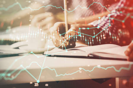 Multi exposure of two men planing investment with stock market forex chart background. Concept of research and trading. Foto de archivo