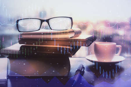 Financial graph hologram with glasses on the table background. Concept of business. Double exposure. Stockfoto