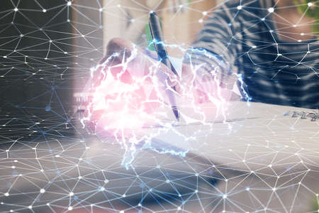 Multi exposure of writing hand on background with brain hologram. Concept of self learning. Archivio Fotografico - 150866933