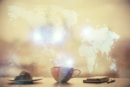 Double exposure of social network theme drawing hologram over coffee cup background in office. Concept people connection.