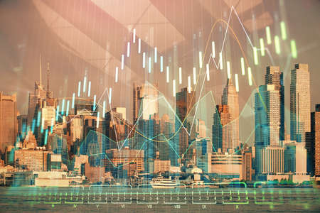 Forex graph on city view with skyscrapers background double exposure. Financial analysis concept. Standard-Bild