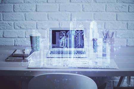 Desktop computer background in office and big town buildings hologram drawing. Double exposure. Smart city concept. Stockfoto