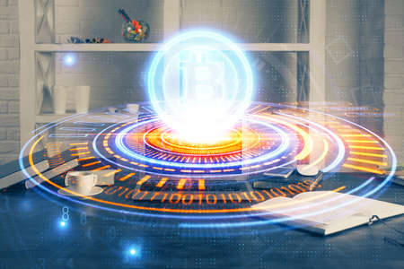 Multi exposure of blockchain theme hologram and table with computer background. Concept of bitcoin crypto currency. 免版税图像