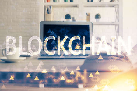 Multi exposure of blockchain theme hologram and table with computer background. Concept of bitcoin crypto currency. Foto de archivo