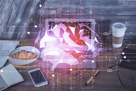 Multi exposure of work table with computer and brain hologram. Brainstorm concept. 免版税图像