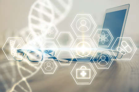 Desktop computer background and DNA drawing. Double exposure. Science concept. Foto de archivo