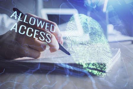 Blue fingerprint hologram over hands taking notes background. Concept of security. Double exposure Foto de archivo